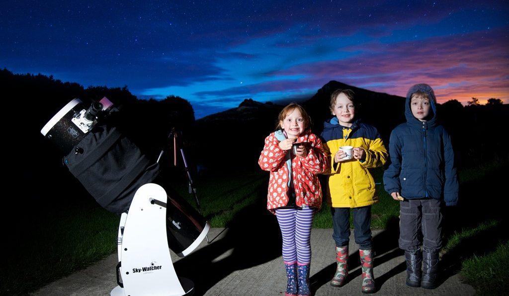 Children stargazing in the National Park