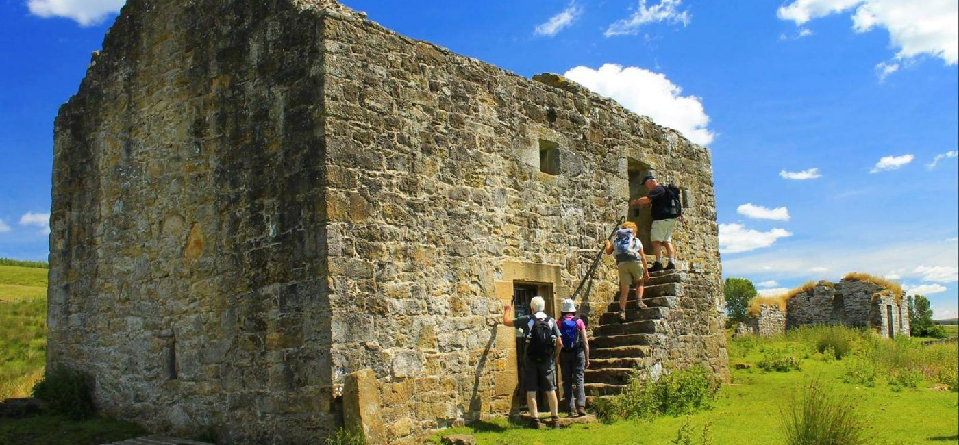 people visiting a bastle house in the national park