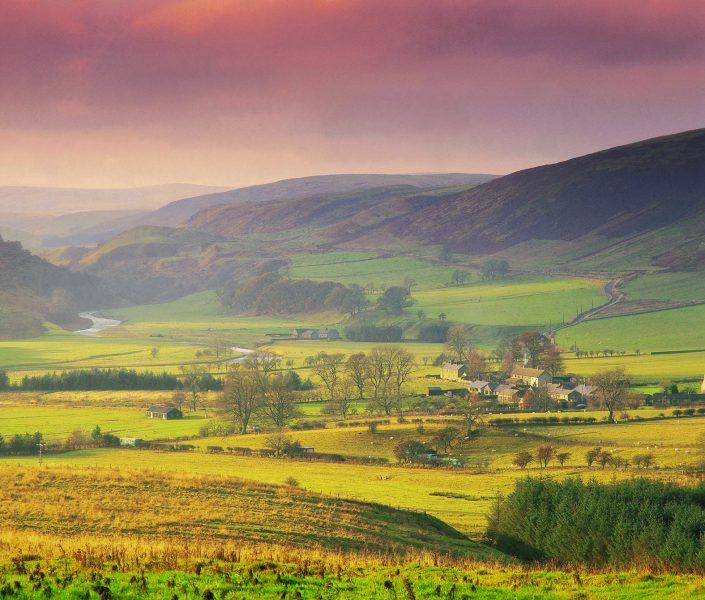A landscape view of Alwinton in Coquetdale with the Cheviot Hills visible in the background