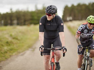 Two road cyclists in Northumberland National Park