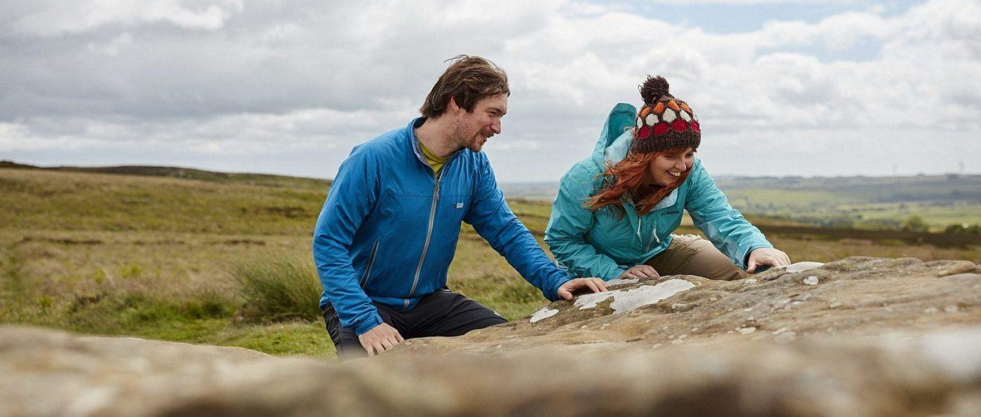 Young couple try geocaching at Lordenshaws