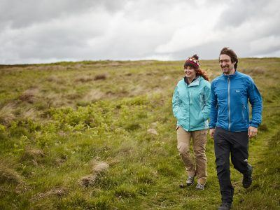 A young couple walking at Simonside in the National Park