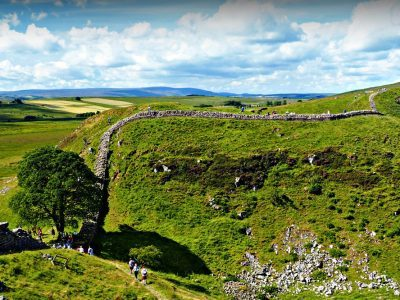 A group of walker at Sycamore Gap on Hadrian's Wall