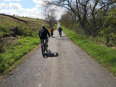 cyclists riding on the road at Hadrian's Wall