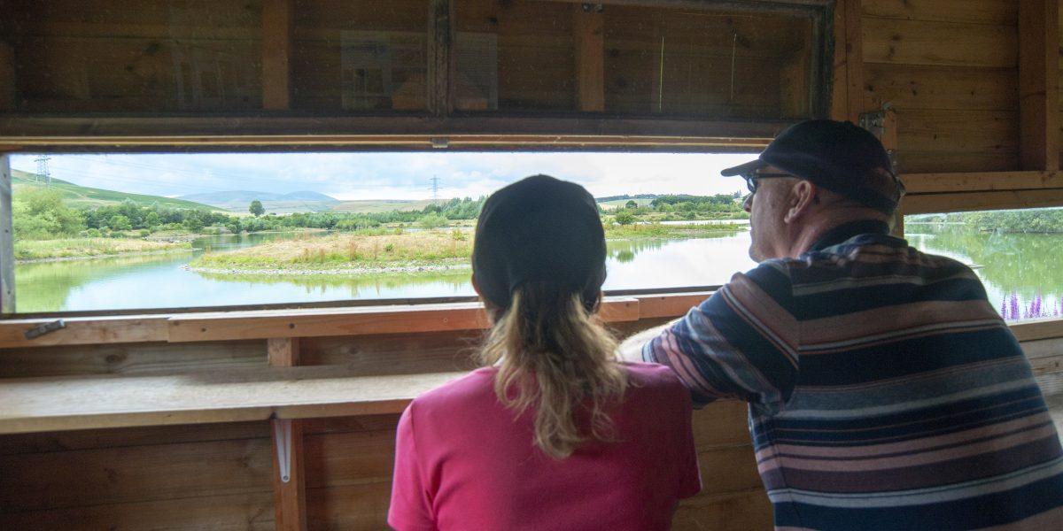 A couple in a birdhide at Branton lakes