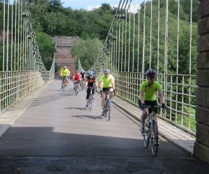a group of cyclists crossing a bridge in north Northumberland