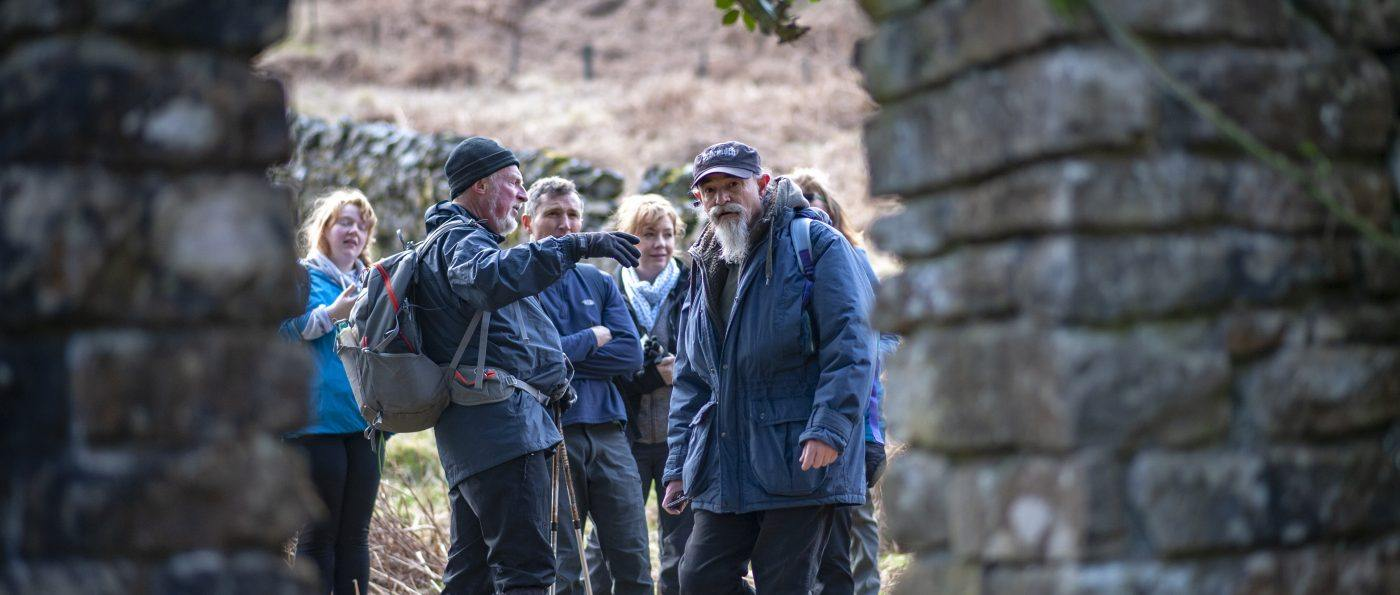 w walk leader talking to a group of walkers on a Guided Walk at Stonehaugh