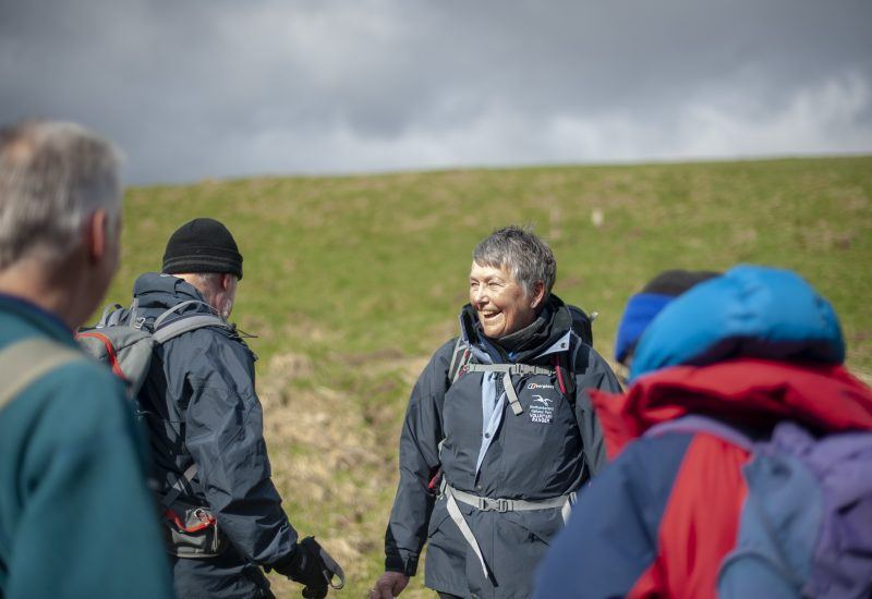 A small group of people enjoying a Guided Walk at Stonehaugh