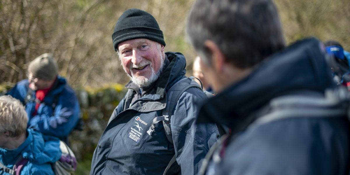 a smiling walk leader leading a Guided Walk at Stonehaugh