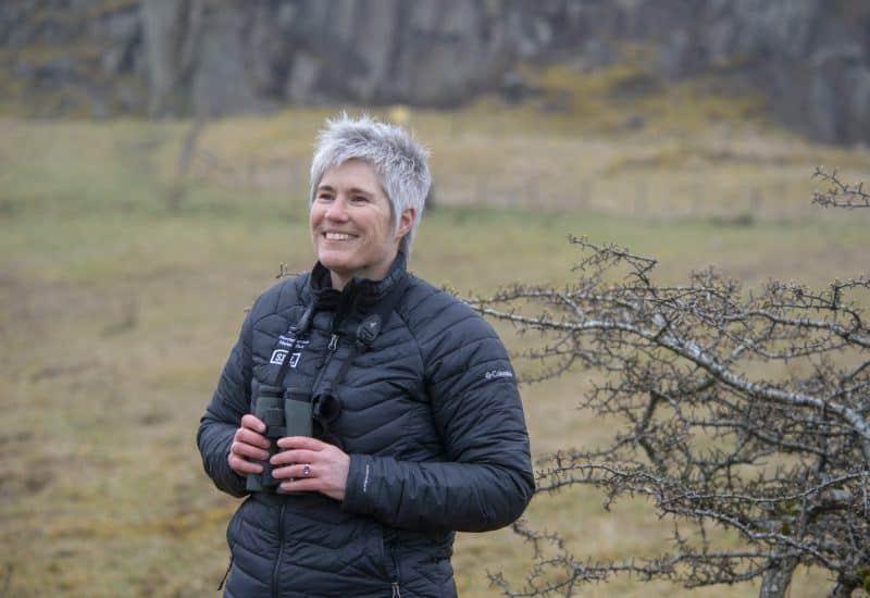 Ecologist Gill Thompson holding binoculars