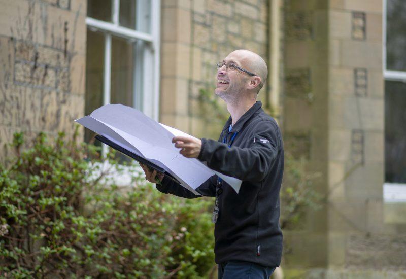 Planner Colin Godfrey holding plans outside