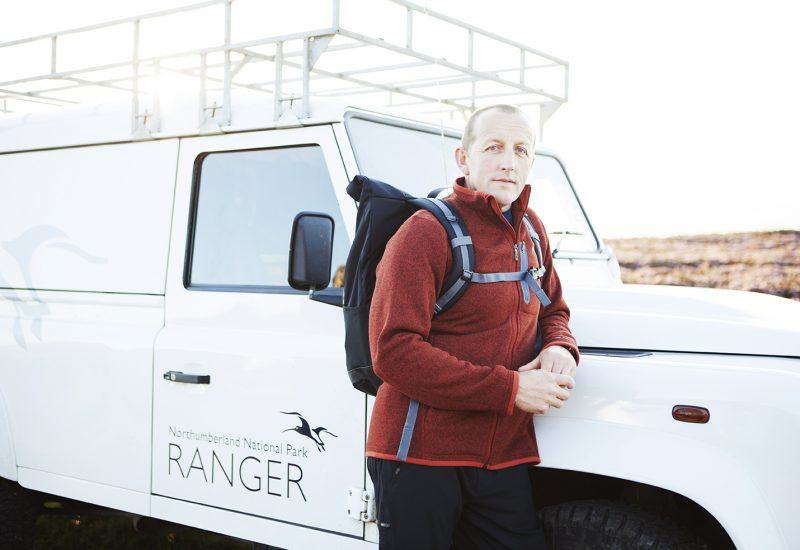 Ranger Mark Bolton next to his vehicle