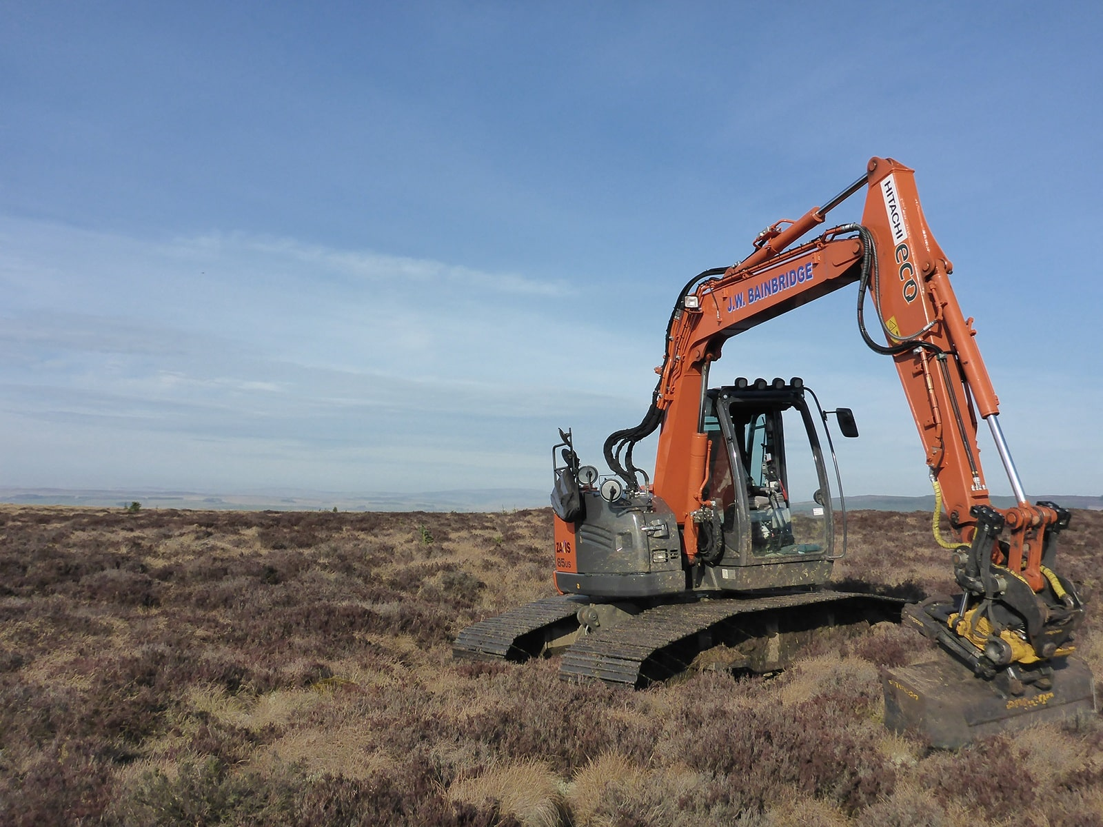 digger on steng moss and cheviot on the horizon