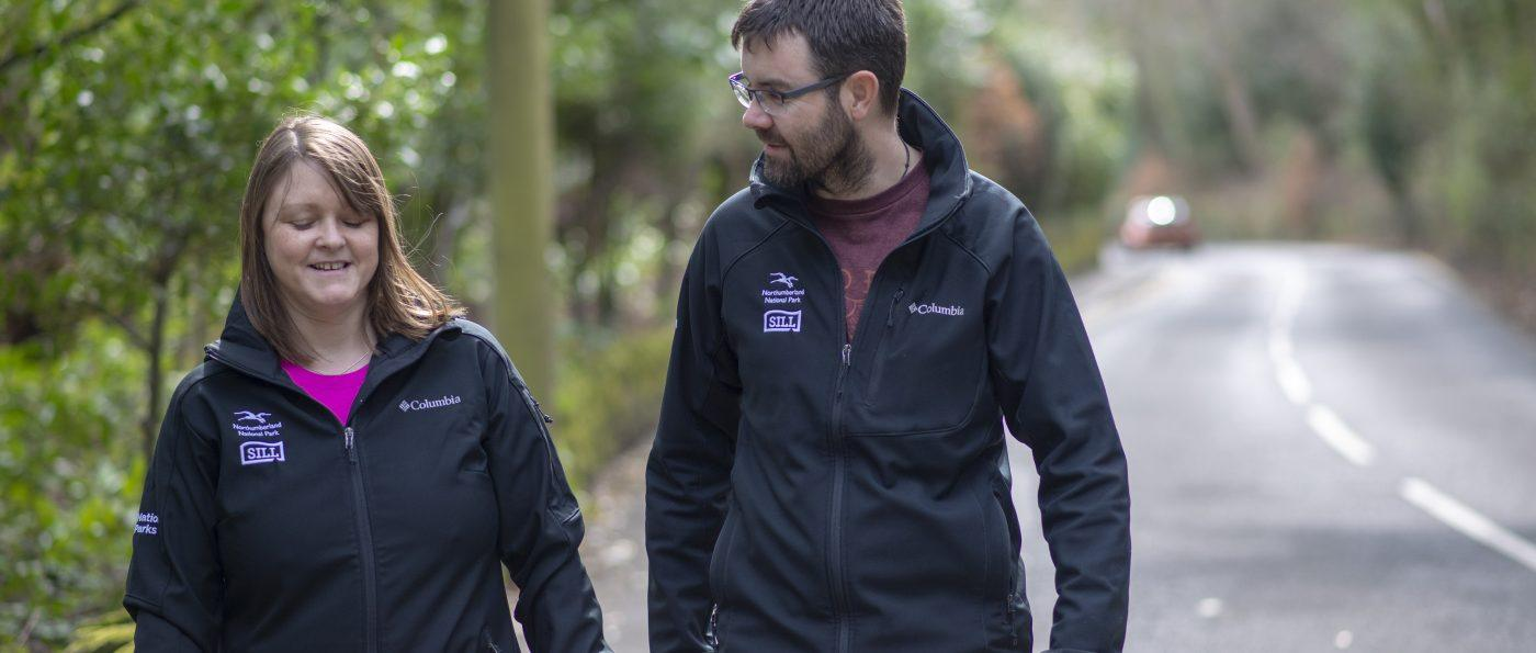 Two members of National Park Staff having a walking meeting