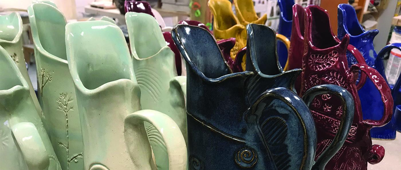 A row of handmade clay jugs