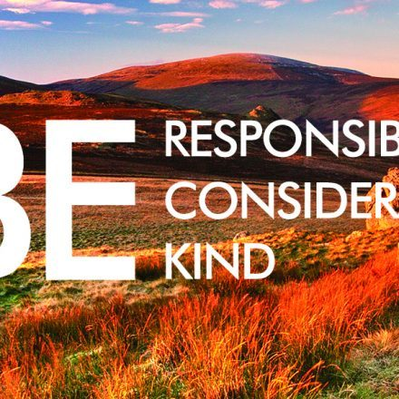 "A view of the Cheviot hills with text overlaid reading ""Be responsible, considerate, kind."""