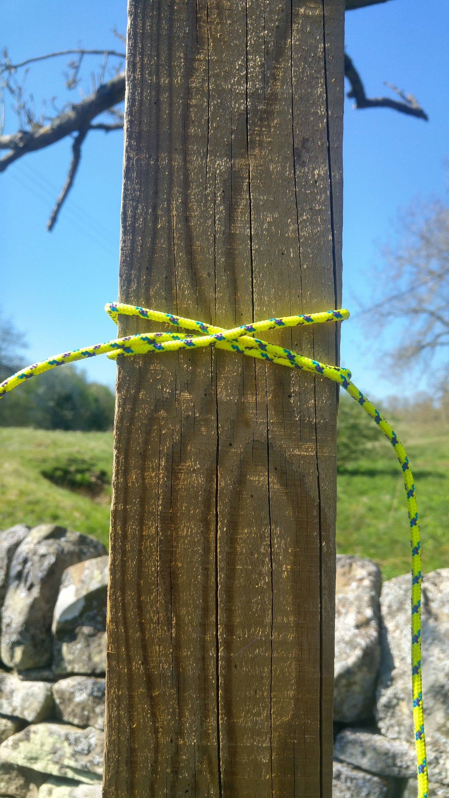 A clove hitch knot wrapped around a fingerpost