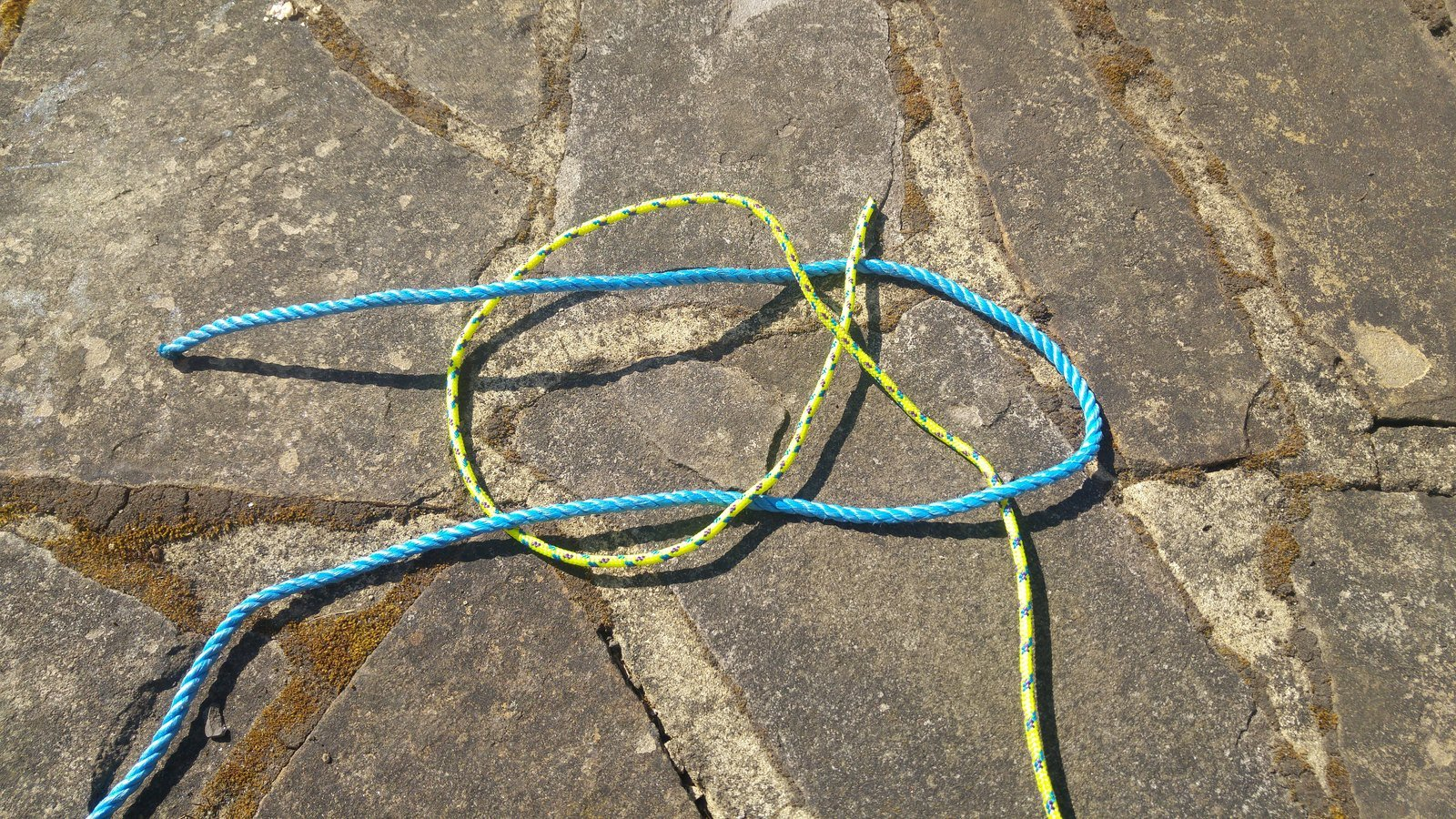A sheet bend knot being created
