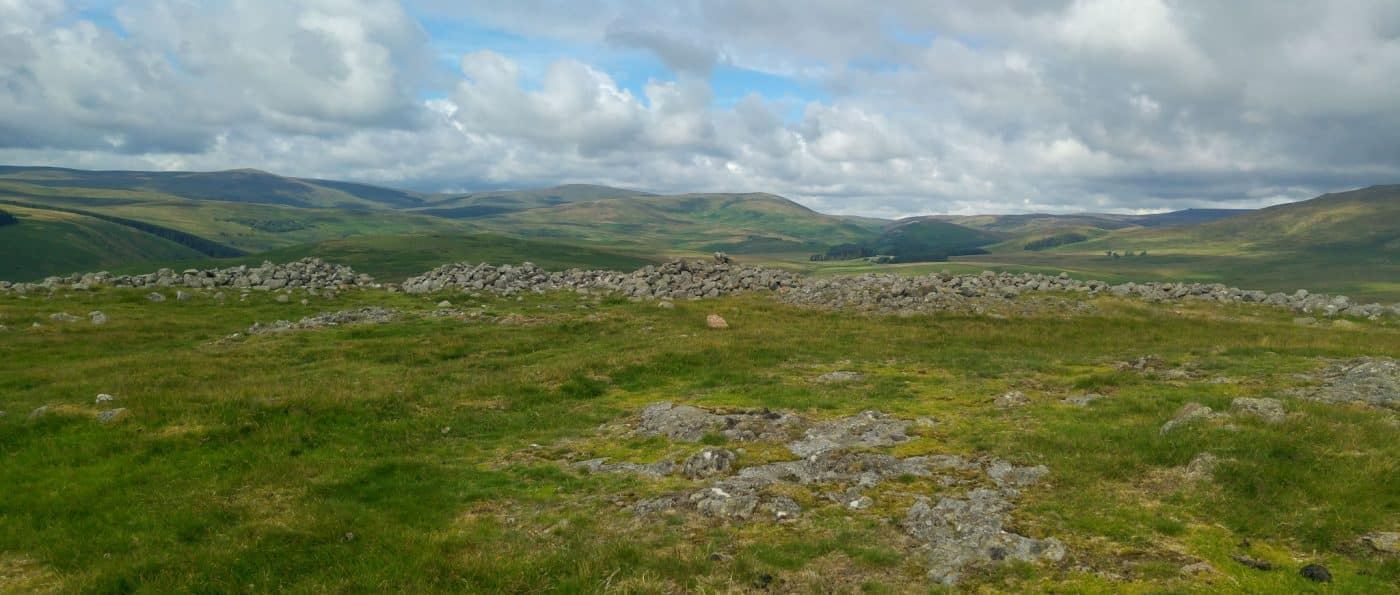 The view from Brough Law Hillfort with in the Cheviot hills in the background.