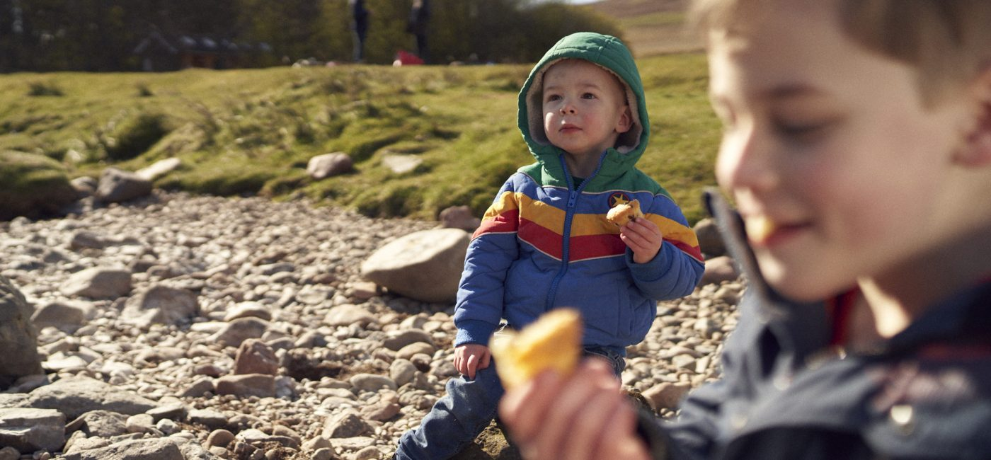 Two small boys enjoying a picnic by the River Breamish