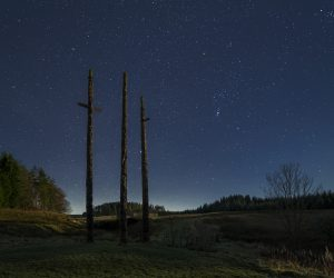Stonehaugh totem poles covers with starry skies