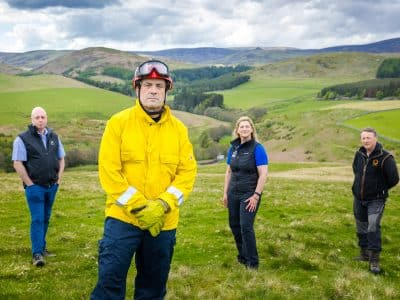 A group of Northumberland staff stood in a row against a backdrop of fields. (L-R) Greg Gavin, Gary Leskey, and Margaret Anderson, John Queen