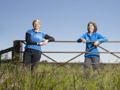 Farming Officers Emma Taylor and Sally Graham stood in a farmers field by a gate