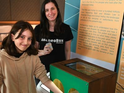 Suzanne, PhD researcher at Northumbria University, and visitor experiencing ARcheoBox at The Sill