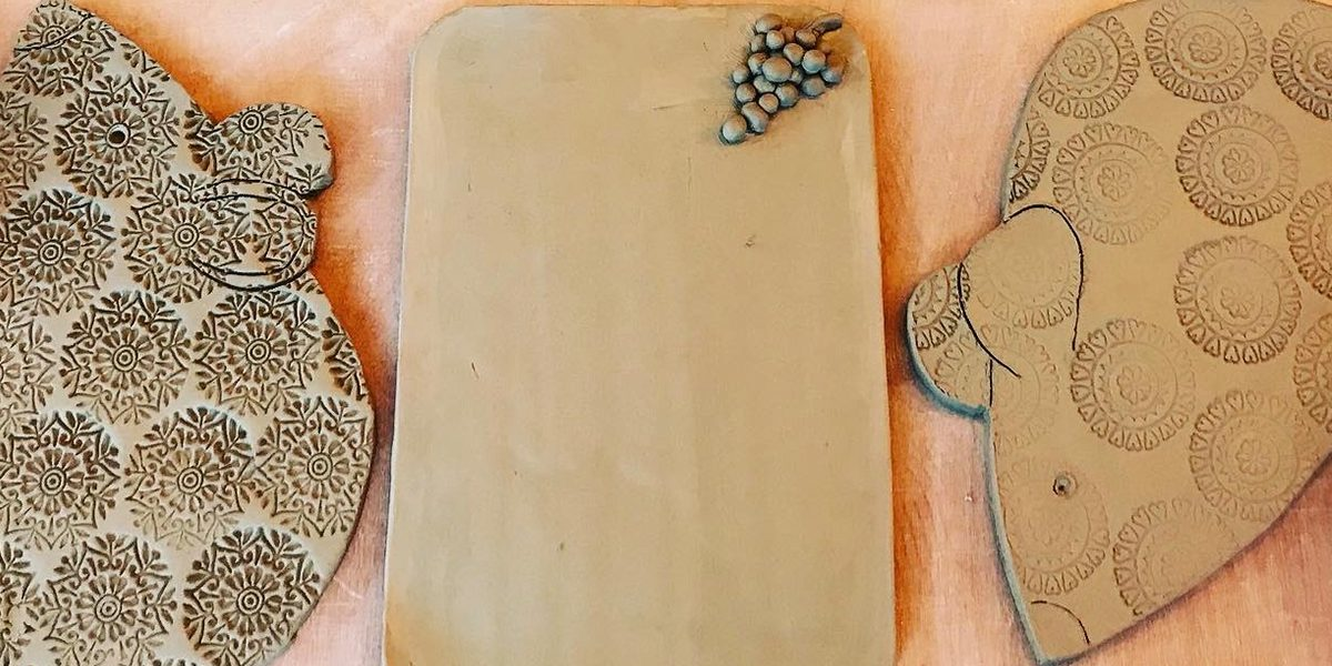 Three, unfired, clay cheese boards