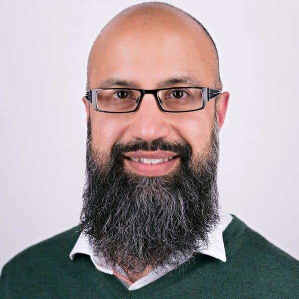 A portrait photograph of writer Wajid Hussain
