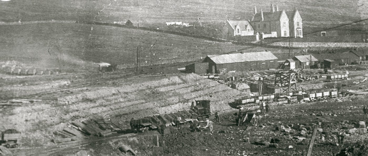 A black and white photograph showing Catcleugh Reservoir mid construction.