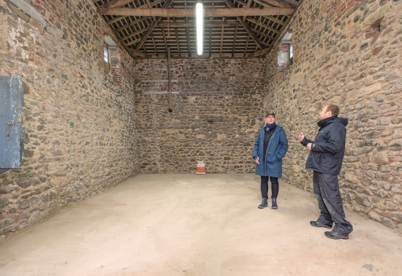 Rebecca Wilson talks to Chris Jones from Northumberland National Park inside one of the historical barns restored at Ingram Valley Farm.